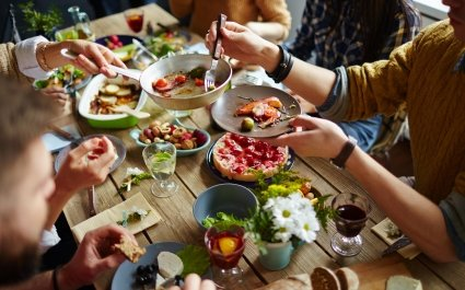 People sitting at dining table and eating - Plus Pack