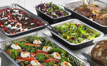 Selection of catering size aluminium trays of hot and cold food - Plus Pack
