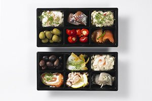 Tapas selection served in black 6-compartment trays - Plus Pack