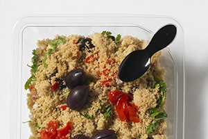 Clear square tray with spoon clicked in corner with couscous salad - Plus Pack